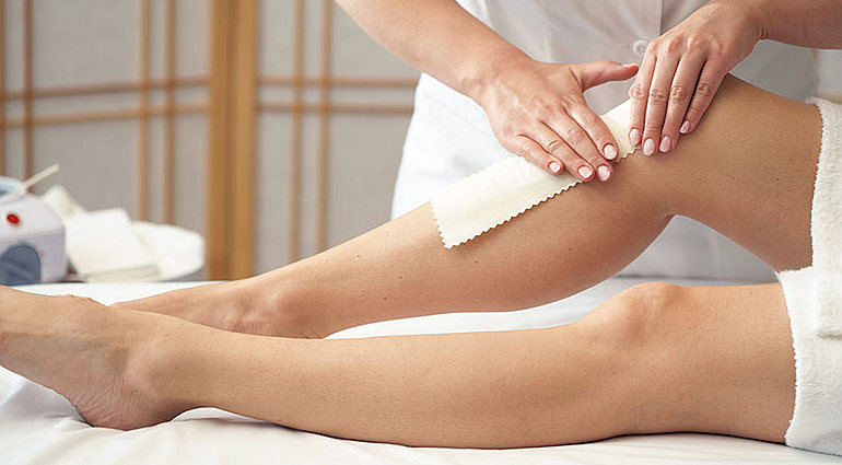 waxing legs at a spa