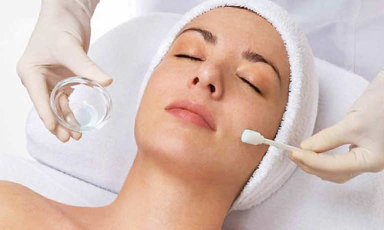 woman getting a chemical peel treatment at spa